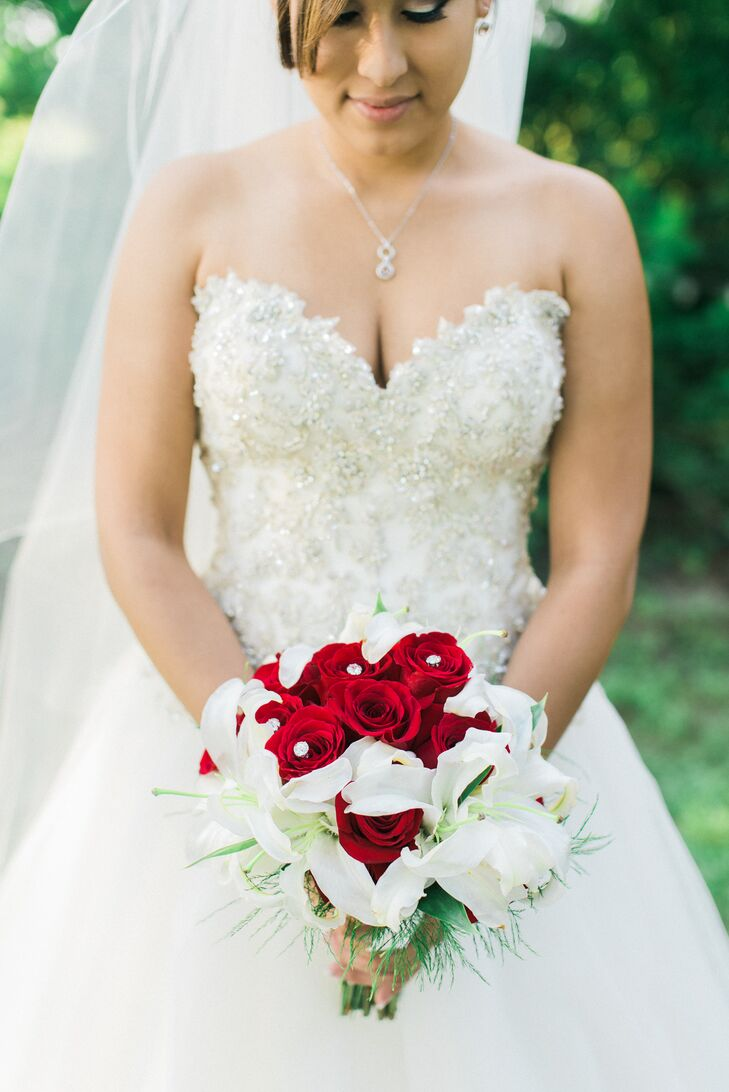 "Laura's bouquet of red roses and white lilies was extra-meaningful to her. ""Any time Matthew gets me flowers, that's what they are,"" she says. Naturally, the Blossom Shop included them in her bridal bouquet."