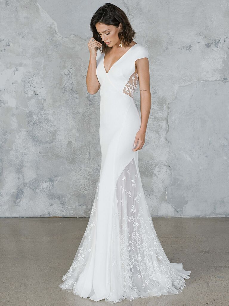 Fitted wedding dress with lace cutouts and cap sleeves