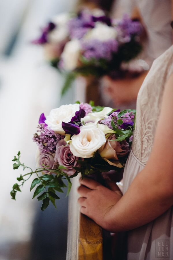 The bridesmaids carried bouquets with ivory and lavender roses with their taupe dresses.