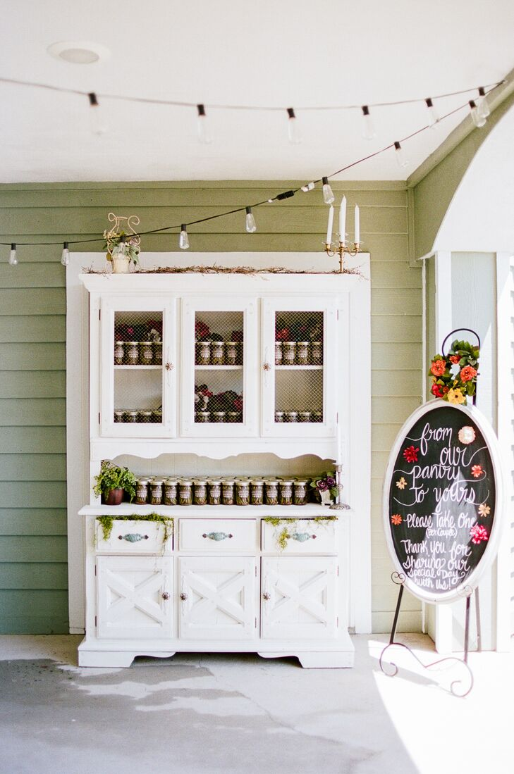 The DIY favors—canned dilly beans—were displayed on a vintage hutch.