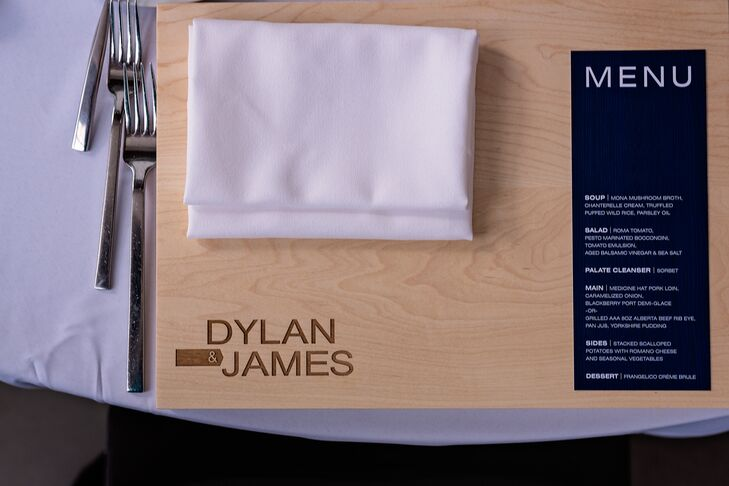 Custom cutting board favors were placed at every place setting at the tables, with a simply folded white linen napkin and navy blue menu card placed on top.