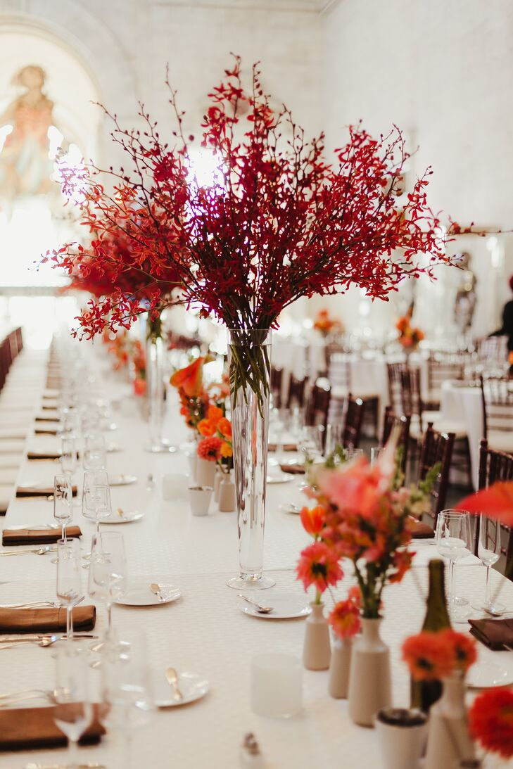 Clusters of James Storie Red Aranthera Orchid Centerpieces
