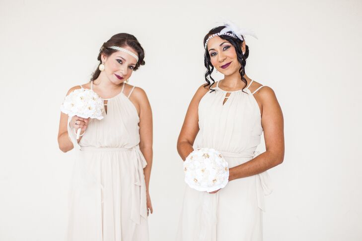 Of course, the bridesmaids also played the part of Gatsby-esque ladies with fun accessories. Each woman wore a neutral halter-strap dress with a pleated skirt and sash along the empire waist. For some added art deco flair, they rocked bold plum lipstick, pearl headbands and refined curled hairstyles. They even matched Jaris with handmade fabric rose bouquets.