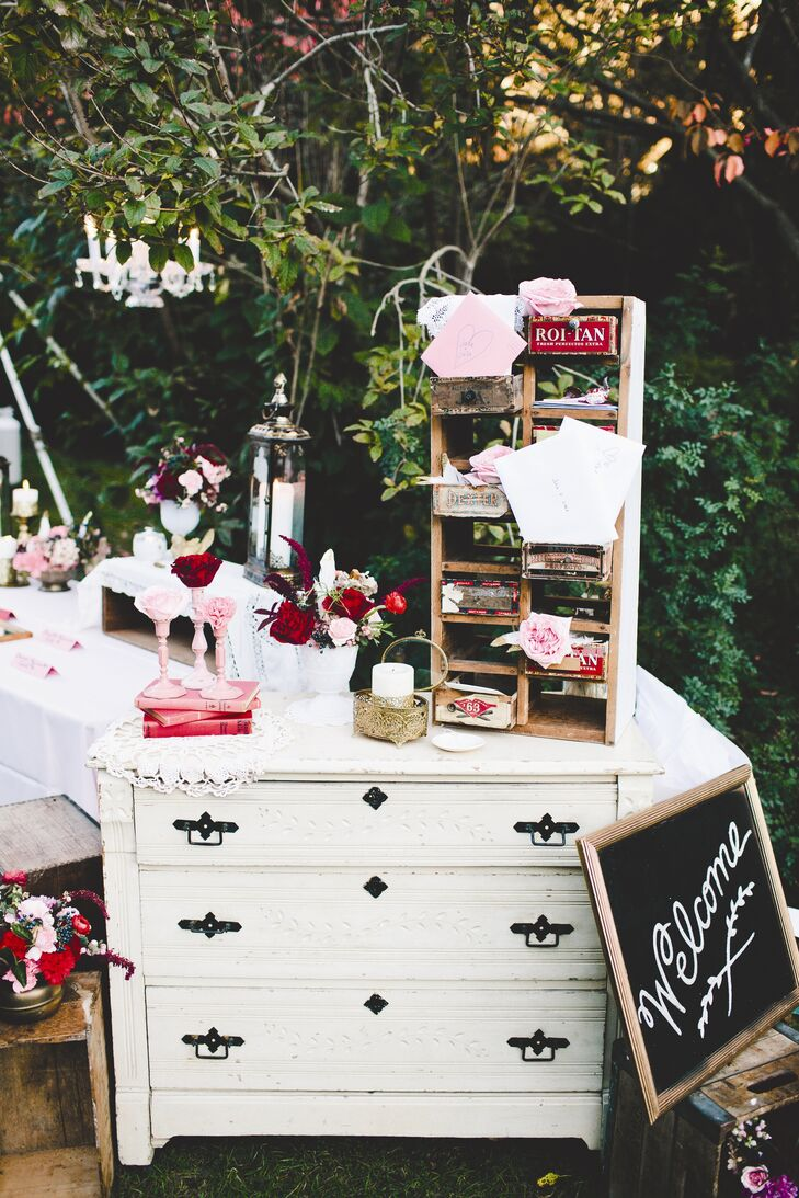"""The welcome table was one of the most beautiful pieces of wedding décor I've ever seen!"" Julia says of the antique bureau with old wooden cubbies for cards that greeted guests at the reception."