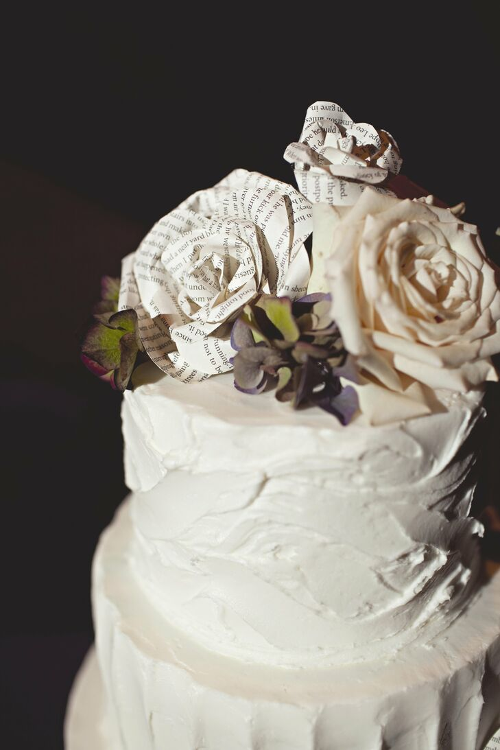 For a romantic look, the cake's buttercream was left messy, and roses, both fresh and made of book pages, served as toppers.