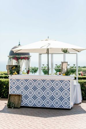 Luxurious Waterfront Bar with Umbrella and Blue Tiles