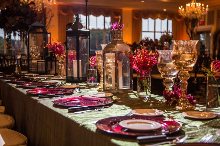 The ballroom at Shenandoah Country Club was decorated with metallic lanterns and candlelight. Dining tables were covered in green tablecloths and arranged with fuchsia chargers.