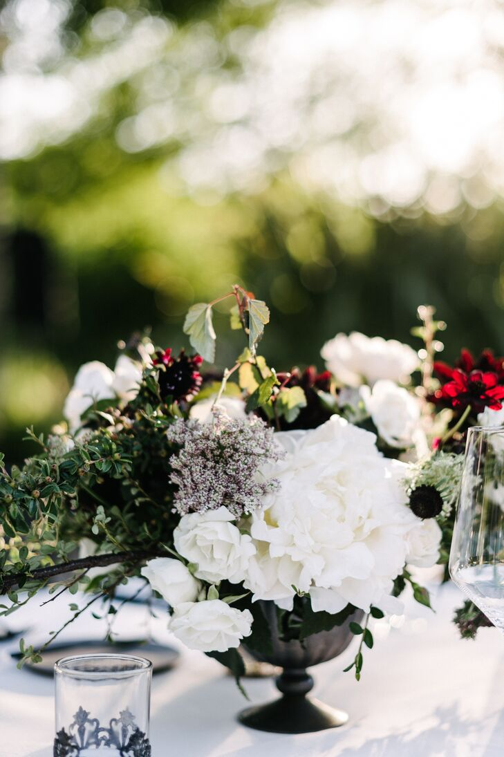 The low-flower arrangements at the reception were eclectic but still had a romantic, moody theme. Dahlias, roses and green vines were used throughout.