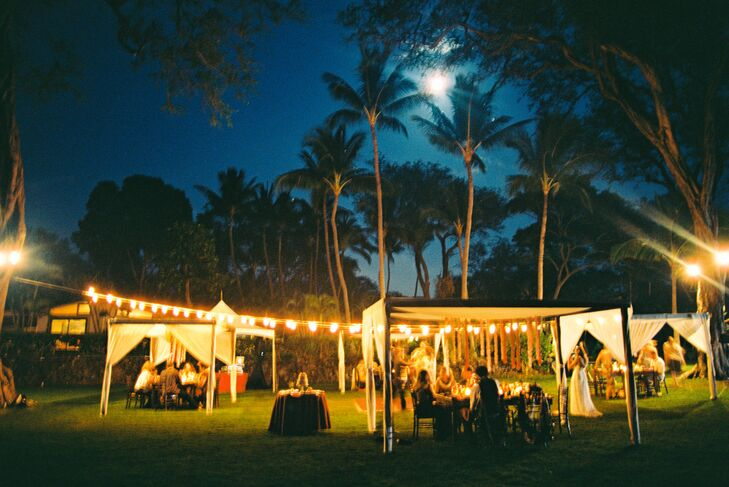 As the moon rose over the palm trees, bistro lights illuminated the dance floor and the four surrounding tables.