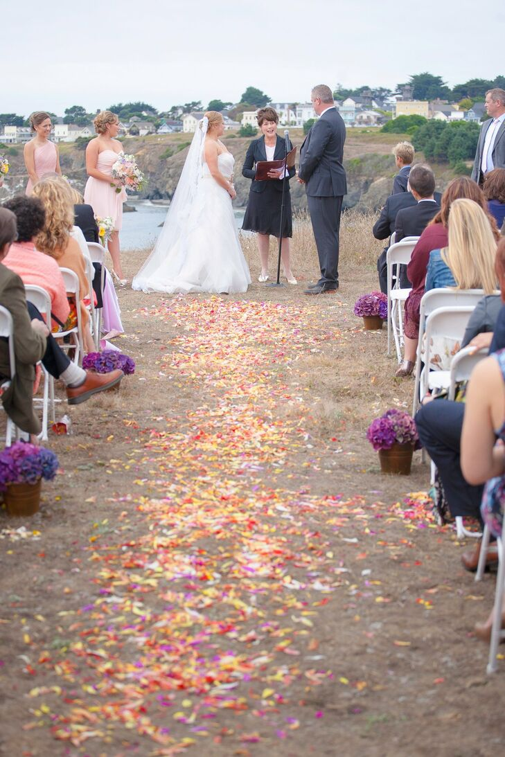 Brightly hued petals lined the aisle at the couple's outdoor ceremony.