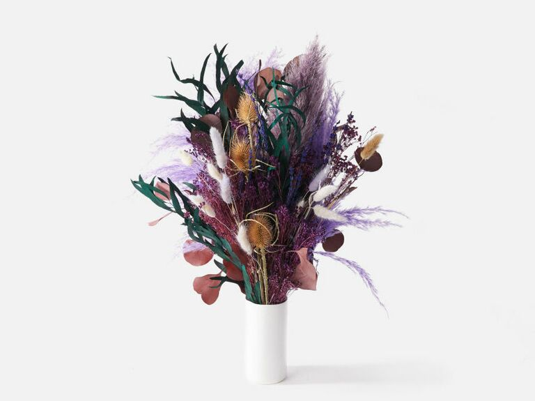 purple, green and orange dried bouquet in white vase