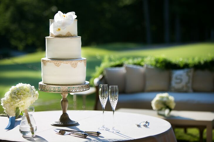 """""""My cake was a representation of my dress,"""" Hayley says. """"Simple yet classic, and the gold touch around each tier was the perfect touch and reminded me of the gold beading around my dress. I loved how it turned out."""""""