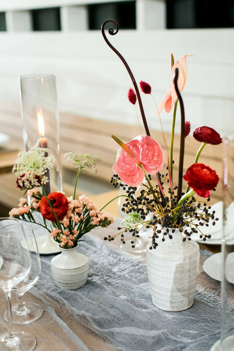 Modern centerpiece with berries and anthurium