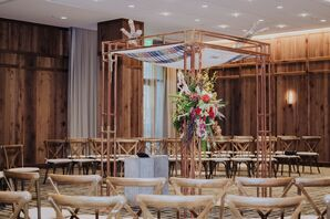 Modern Gold Chuppah with Flower Arrangements in Hotel Ballroom