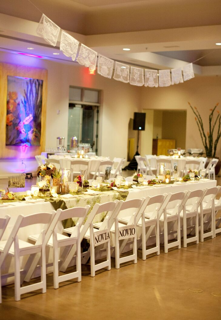 The couple and their guests moved indoors for the reception, where the tables were decorated in a warm autumnal color palette.