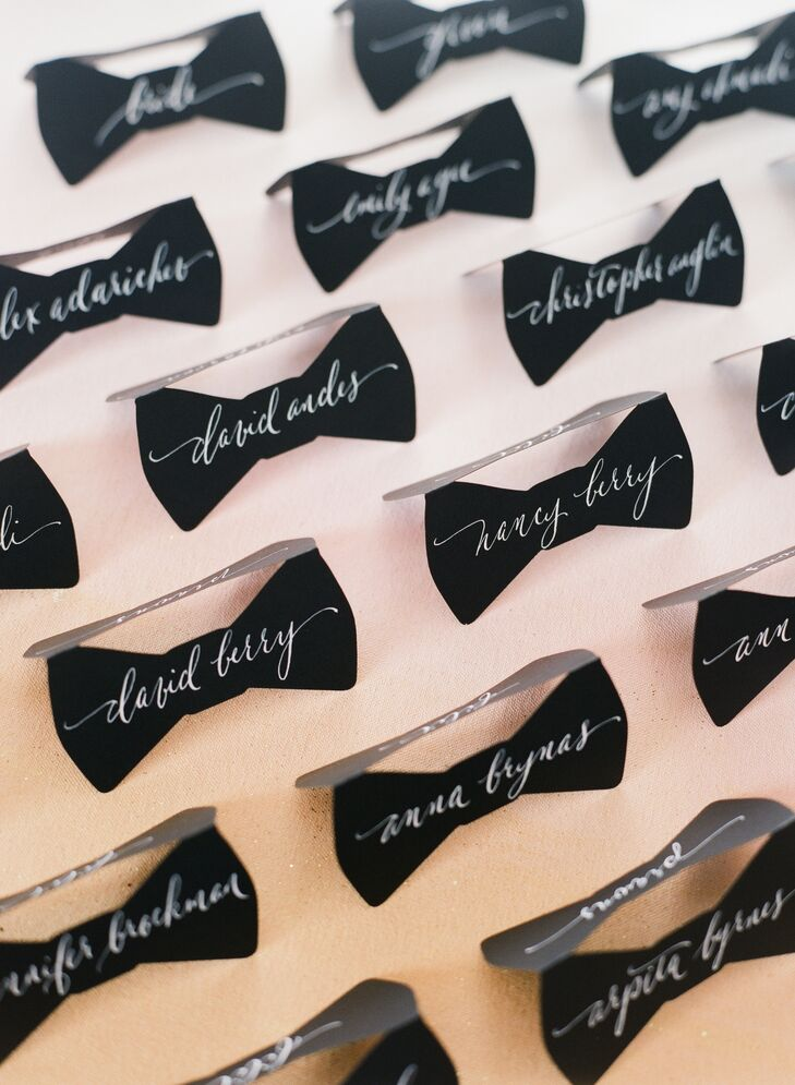 "Lynn ordered adorable black bow tie escort cards for the wedding, and had their calligrapher use white ink to write each guest name onto the fronts and backs. ""They turned out phenomenal and we received so many compliments on them,"" she says. ""Some guests still have them."""