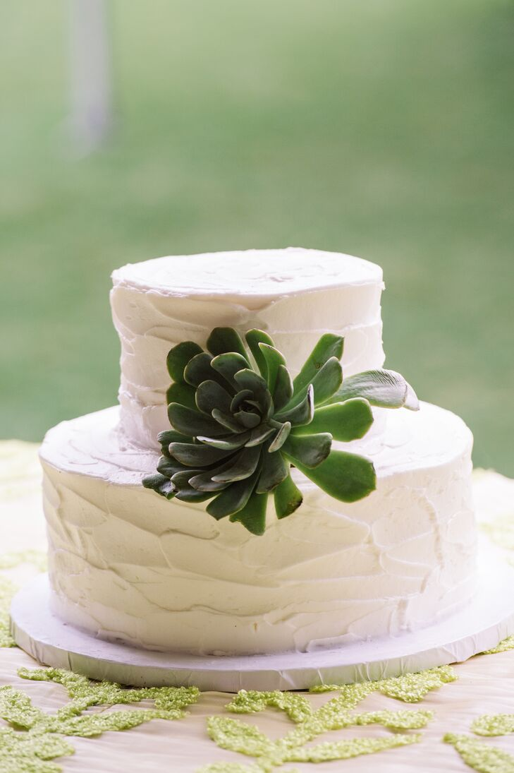 Sometimes adding a bold floral to an otherwise plain dessert can really make it stand out. Caroline and Christopher knew they wanted a simple wedding cake, so they picked a two-tier ivory confection from Fatty Patty's Cakes & Cafe. The round layers were covered with buttercream frosting and then topped with a single succulent at the center.