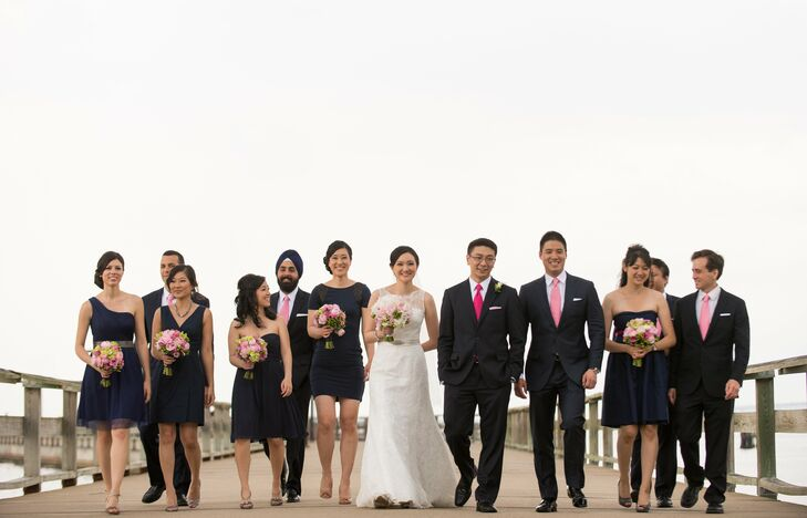The men's pink ties added a bright pop of color to the navy blue wedding party attire.