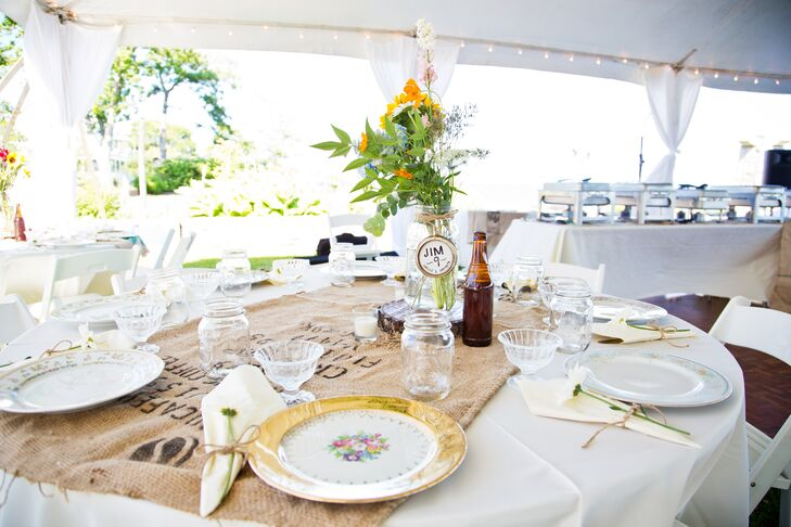 """The couple decorated their relaxed tented reception with a """"rustic vintage sea"""" theme. """"It was burlap meets sailboats,"""" says Shelly. """"It was girl from Iowa meets boy from the coast and we wanted it to be extremely personal!"""""""