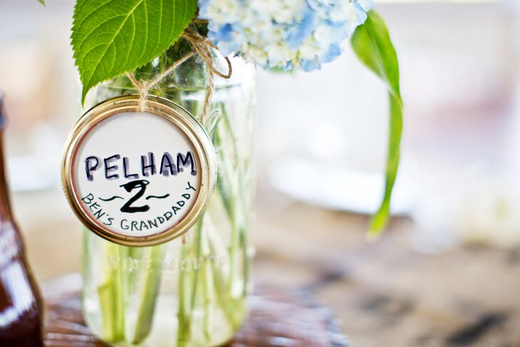 A dear friend of the couple is a florist at A New Leaf in Chicago and worked with the couple's friends to arrange mixed local flowers in jars that were labeled with names of family members who had passed.