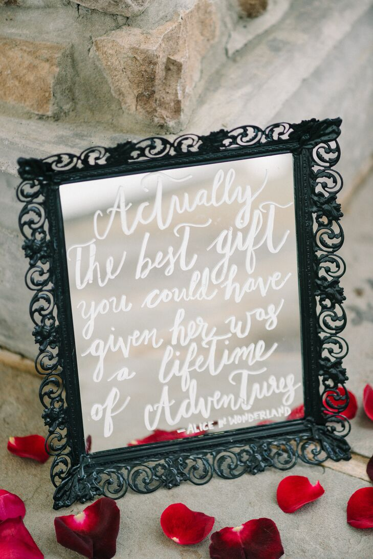 """Their reception decor also included a few personal references to """"Alice in Wonderland."""" Sarah and Steve call their entire relationship an adventure. So this quote, which is often tied to the book, connected the couple's sweet wedding day with their theme."""