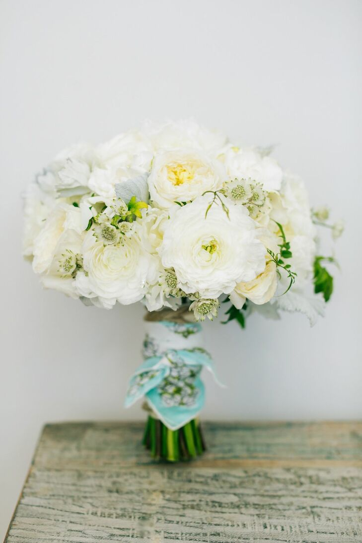 """""""My bridesmaid bouquets comprised white roses and dusty miller leaves with exposed stems wrapped with twine,"""" says Leah, who relied on Orange's BloomBox Designs for all the day's flowers."""