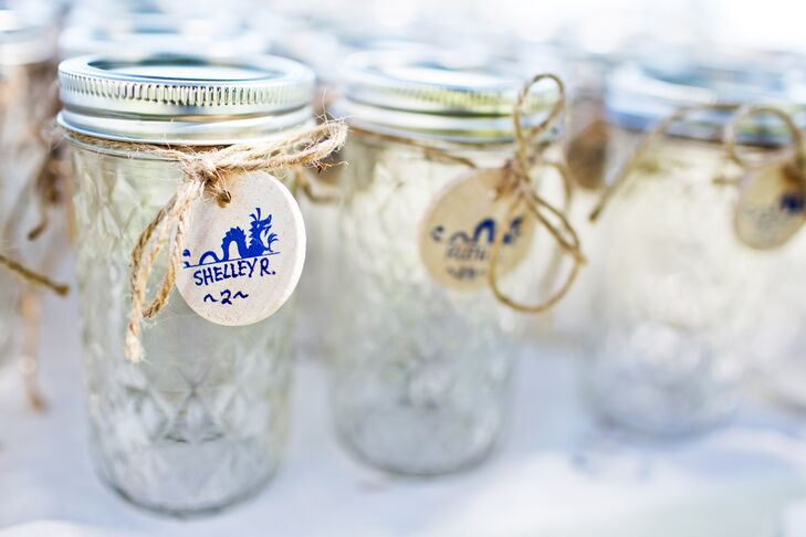 Guests received personalized jars and proceed to kegs filled with beer brewed by the bride's stepfather (the father of the groom.