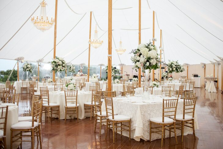 "After saying their ""I do's"" in a traditional Catholic ceremony, the newlyweds and their guests headed to the Figure Eight Yacht Club for a tented reception overlooking the water. The elegant Sperry tent set a classic yet laid-back tone, which the couple built upon with a palette of soft, neutral hues. Tables were topped with textured ivory linens; lace and gold cutlery added a regal glint to the tablescapes."