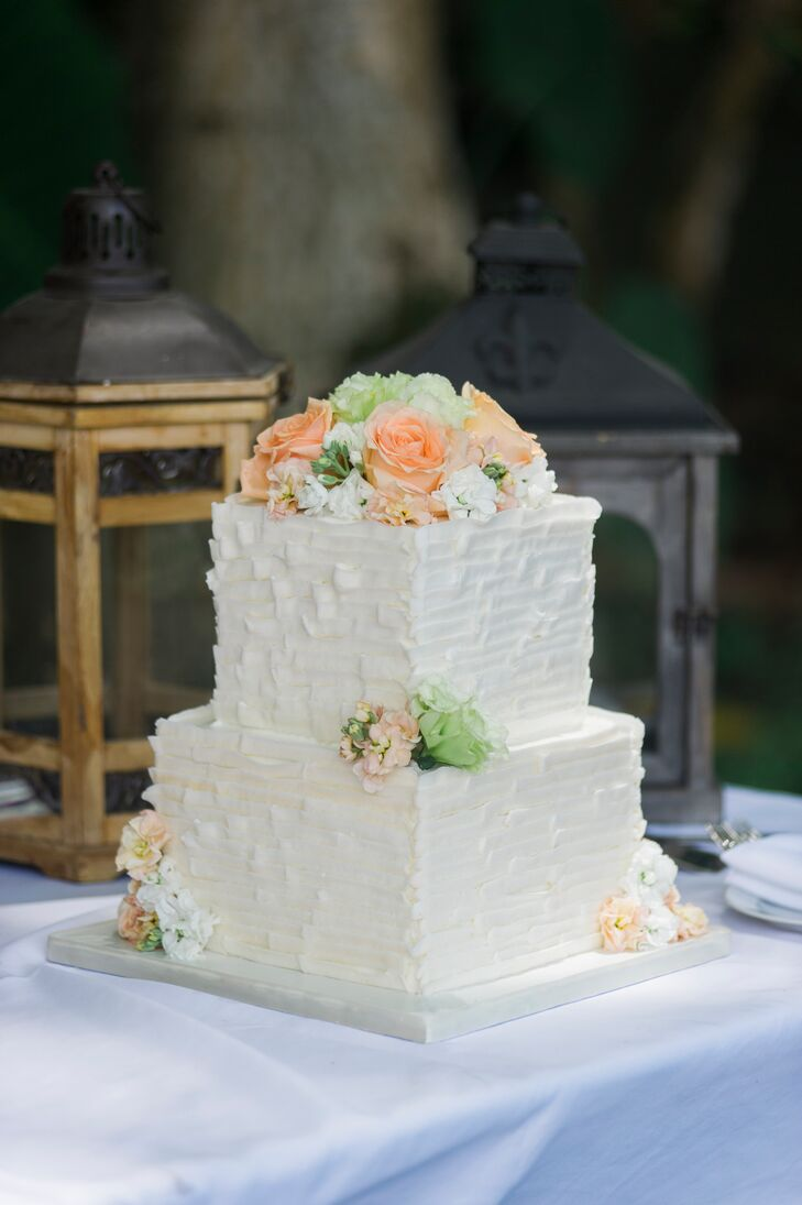 Two tier square pink and white wedding cake with brush
