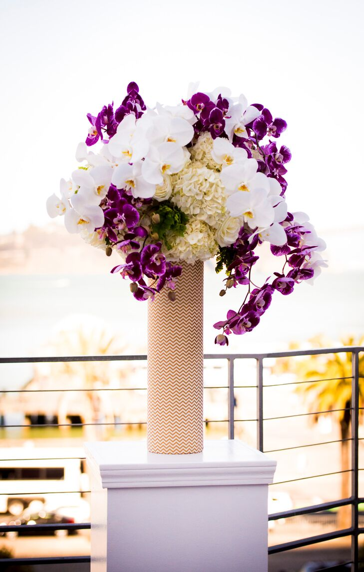 Tall flower arrangements decorated the terrace, with a mix of purple and white orchids and ivory hydrangeas.