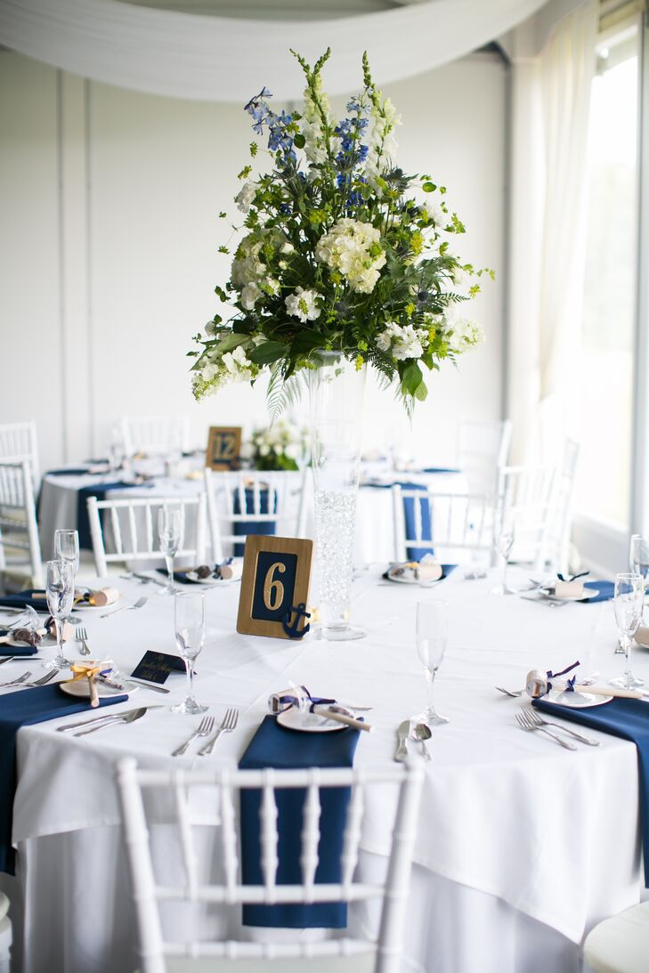For the centerpieces from the Gateway Florist, they went with a more natural twist on the theme. Each low or tall arrangement was filled with white hydrangeas, white delphiniums, greenery, wildflowers and of course blue sea holly (to tie in their colors). The flowers seemed to top each clear-glass vase with no stems in sight. (How cool is that?)