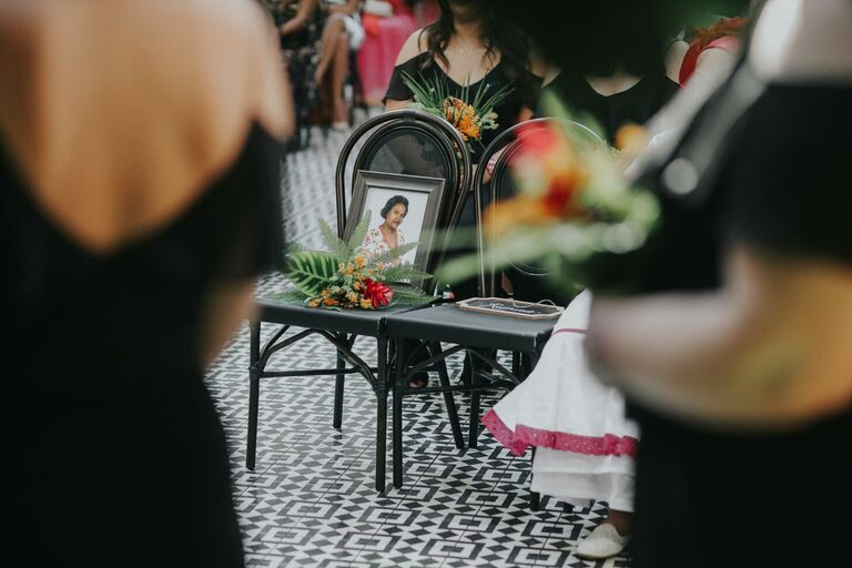Framed picture of loved one at wedding ceremony