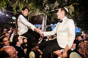 Grooms Dancing the Hora with Guests at Reception