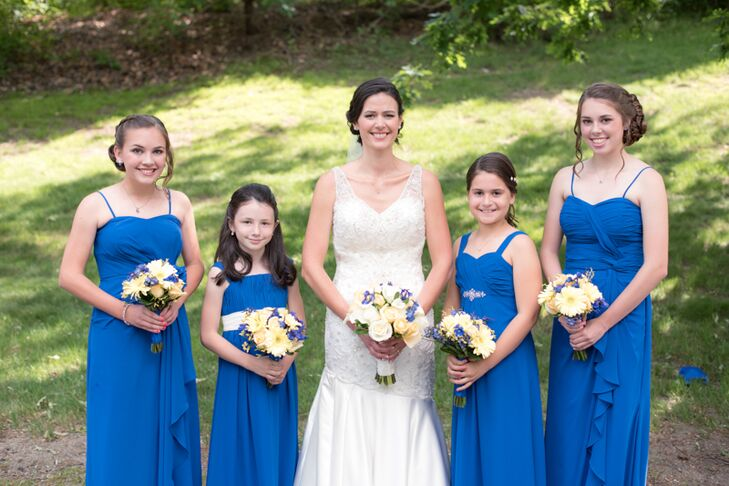 "Katie and Steve's daughters and nieces made up Katie's bridal party. When it came to choosing dresses for the wedding day, Katie took all the girls to Blushing Bride to find the perfect frock. Bill Levkoff's line of bridesmaid dresses offered an extensive variety of styles for the girls to choose from and Katie had them all choose a gown that they loved in a bright horizon blue hue. ""Since all the girls are different ages, ranging from 8 to 15, each chose a different style that best suited them,"" Katie says. ""It worked out beautifully."""