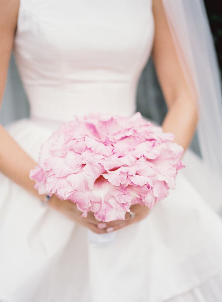 """My bouquet was in the glamelia style—a style that was popular in the 1940s and '50s,"" Ivy says. ""It is made of pale pink gladiola petals, but I have seen them done with rose petals and other flowers as well. The bouquet starts with one single gladiolus bloom, and the florist surrounds that with several layers of matching petals. The result is a giant single bloom the size of a dinner plate! I love how the pale pink contrasts against my gown."""