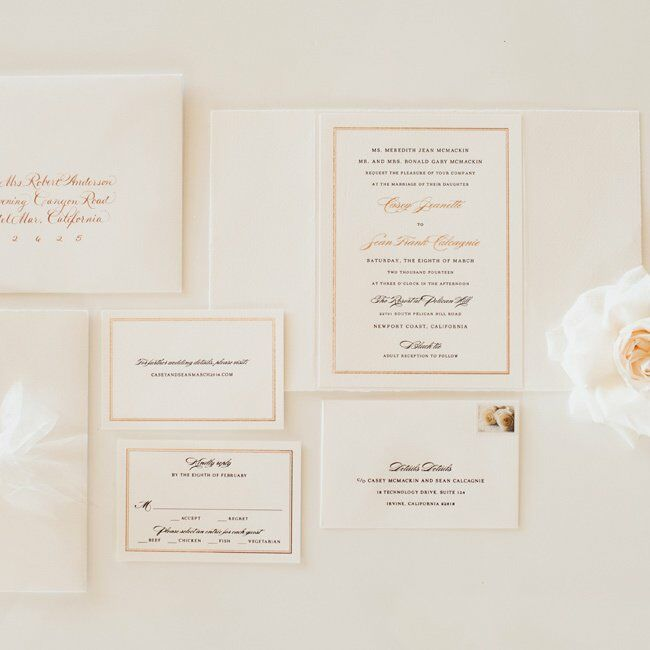 Casey and Sean custom designed their formal wedding invitations with rose gold foil and white ribbons.