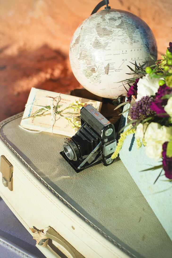 Decorative vintage cameras and globes drove home the vintage travel theme.