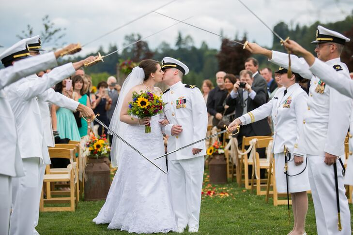 As Justine and Josh exited the ceremony, friends from the military lined the aisle and held their swords around the couple.