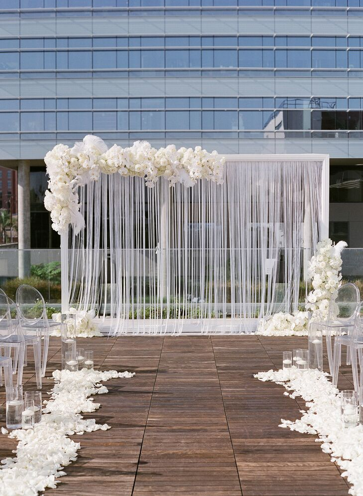 Modern Ceremony Arch with Streamers and White Flowers