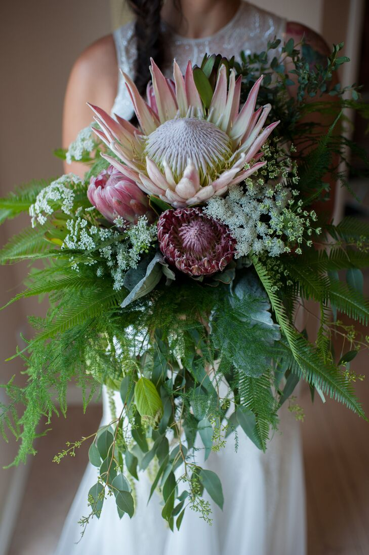 Victoria used stunning king proteas and plenty of lush ferns in her rustic  bouquet.