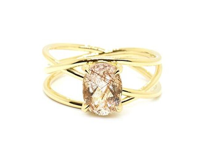 Rutilated Quartz engagement ring in four claw basket setting