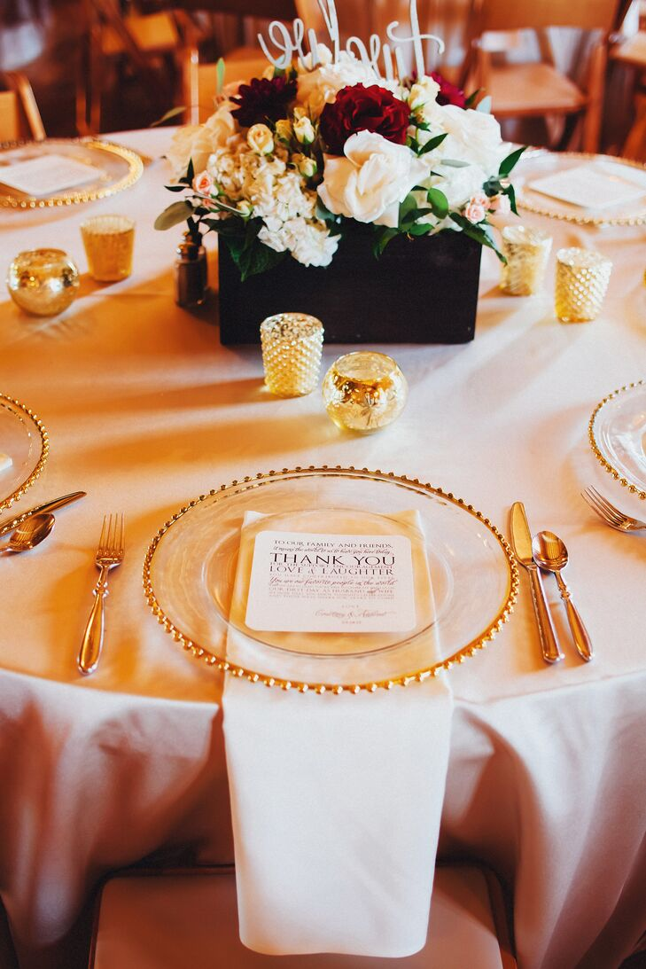 Glass chargers with gold bead edges and gold flatware sat at each place setting, along with a thank-you note from Courtney and Andrew to each of their guests.