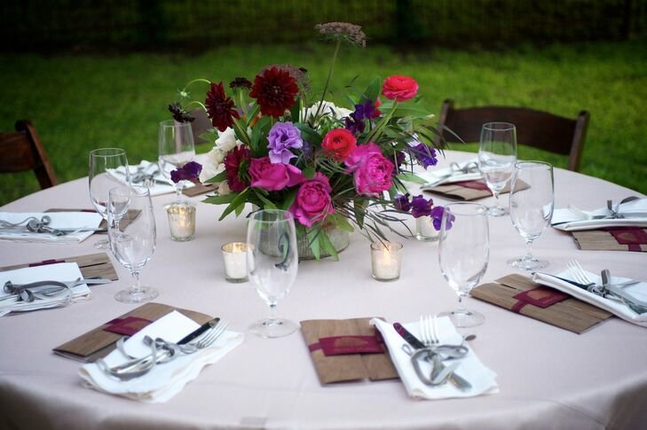 A centerpiece arrangement of dahlias, roses and ranunculuses added a vibrant touch to the table decor.
