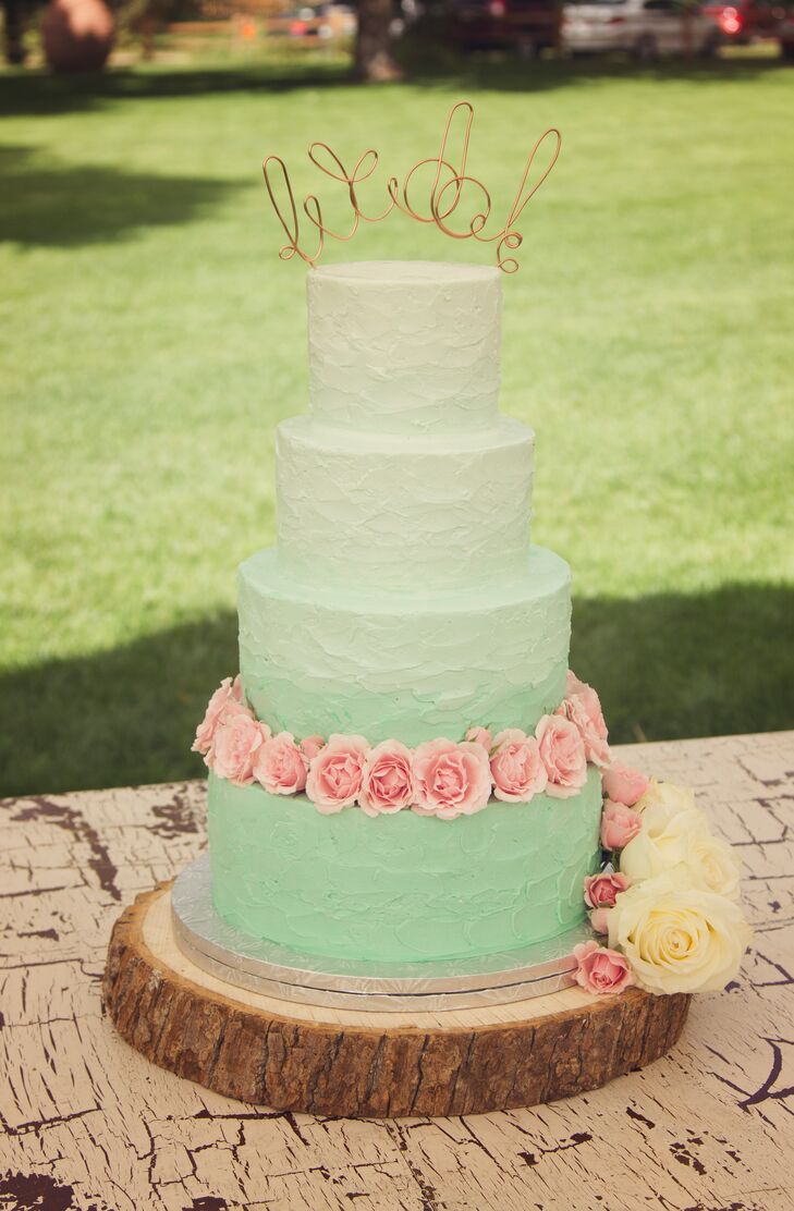 "Indulge Bakery made the couple's wedding cake. ""I would highly recommend them,"" Milena says. ""They were able to design a cake perfectly to my idea and the cake tasted wonderful. I mean we had a layer of chai cake with gingerbread frosting, how could it have not!"""