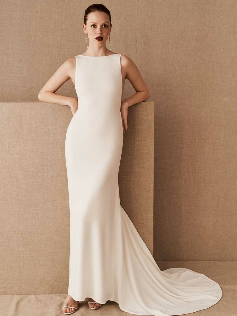 Simple white wedding dress with high neckline and open back