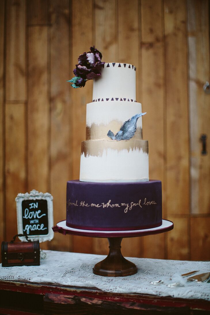 """Paulina and Anthony used their marsala, gold and dusty blue color scheme as inspiration for their four-tier cake. """"I painted a burgundy peony on our invitation, and Nickol [the cake maker] created one made of fondant to top our cake,"""" Paulina says. """"She added a couple of fondant feathers to match our dream catchers, and she included our wedding saying, 'I have found the one whom my soul loves.' """""""