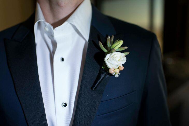Greg and Fletcher's boutonnieres were slightly different, but included ivory and peach flowers with added succulents, which coordinated with the flowers at the outdoor ceremony.