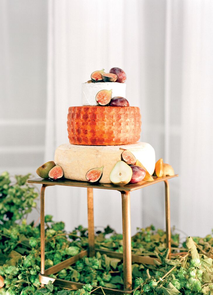 A big foodie, Lauren is usually disappointed by traditional wedding cake. As an alternative, the couple opted for stacked cheese wheels, homemade candy bars and doughnuts.