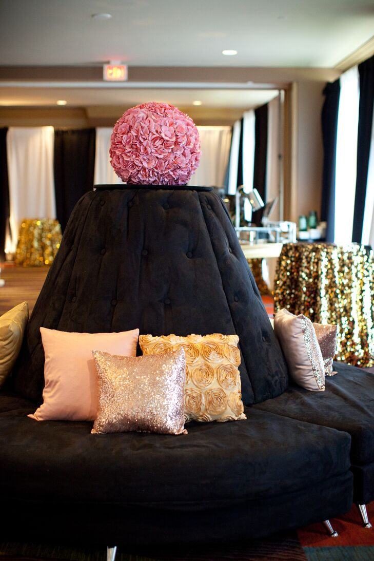 Black Couches And Gold Throw Pillows At Cocktail Hour