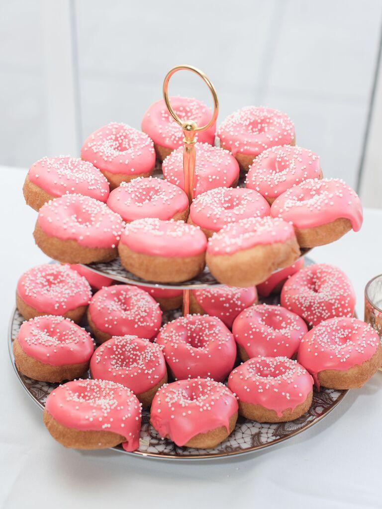 pink frosted doughnuts wedding dessert